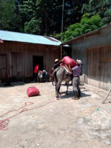 Transporting food donations amid tough road conditions to communities in Colon, Honduras.